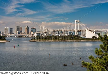 Tokyo / Japan - October 18, 2017: Rainbow Bridge And Tokyo Cityscape, View From Odaiba Island Across