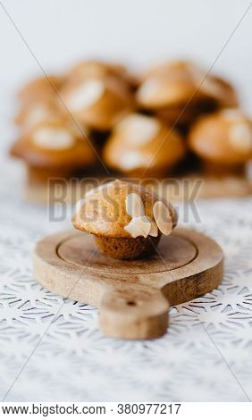 Selective Focus Homemade Muffin On Wooden Tray With White Table And White Background