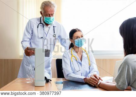 Medical Doctor Woman And Team Held The Hand And Consoled And Comfort The Patient In Hospital And Cli