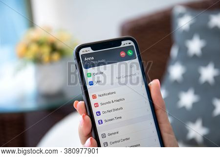Alanya, Turkey - August 9, 2020: Woman Hand Holding Iphone 11 Ios 14 With Phone Call Widget On The H