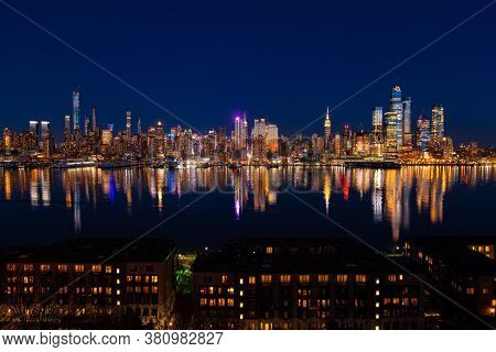 New York City midtown skyline at night with architecture