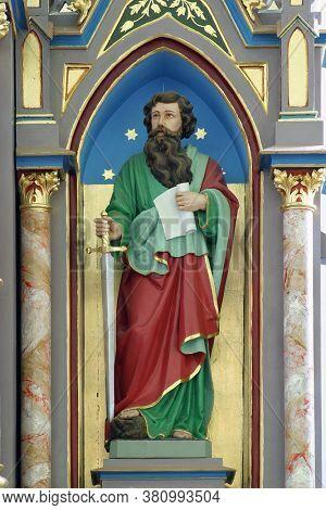 LUKA, CROATIA - SEPTEMBER 16, 2012: St. Paul's statue on the main altar at St. Roch's Church in Luka, Croatia