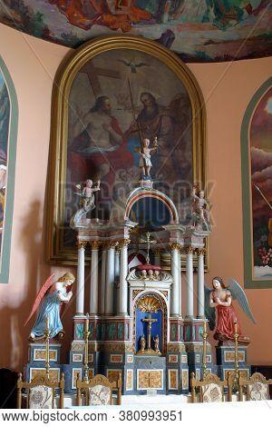 KRALJEVEC NA SUTLI, CROATIA - SEPTEMBER 16, 2012: The main altar is the Parish Church of the Holy Trinity in Kraljevec na Sutli, Croatia