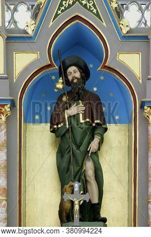 LUKA, CROATIA - SEPTEMBER 16, 2012: St. Roch statue on the main altar at St. Roch Church in Luka, Croatia