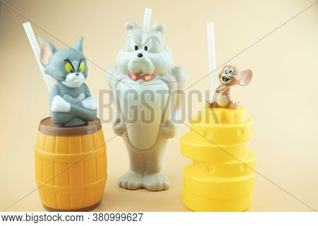 Bangkok, Thailand - August 16, 2020 : Set Of Plastic Drink Cup Tom And Jerry To Promote The Movie Of