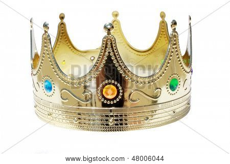 A Genuine Plastic King or Queen crown in Gold Plastic with Colorful Plastic Jewels isolated on white with room for your text. The perfect image for all your Royal Crown Needs.