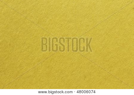 close up aka macro shot of yellow construction paper, showing texture, paper fibers, flaws, and more. the perfect image for all your colored construction or recycled paper needs