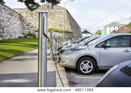Electric Car Plugged In To Electricity