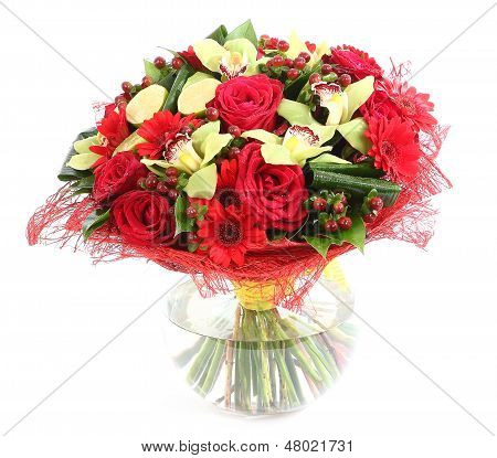 Floral Composition In Glass, Transparent Vase: Red Roses, Orchids, Red Gerbera Daisies. Isolated On
