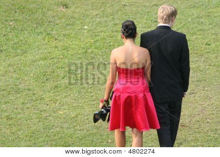Couple In Formal Attire Walking Away