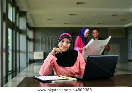 Young asian muslim woman in head scarf smile