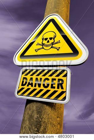 Danger skull sign against the evening sky poster