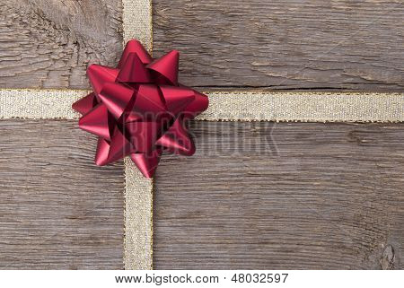 Red Bow On Golden Ribbon