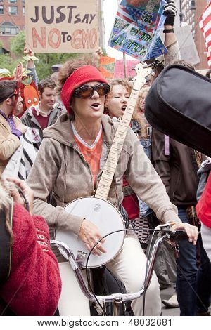 NEW YORK-MAY 25: A protestor on a bicycle strums a banjo and sings during the March Against Monsanto, a global movement against GMO's near Union Square on May 25, 2013 in Manhattan.