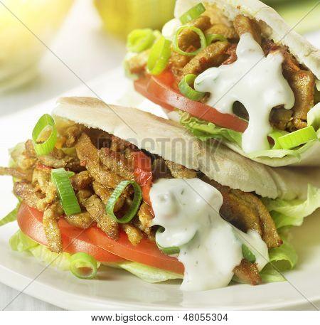 Pita Stuffed With Shawarma Tomato And Lettuce