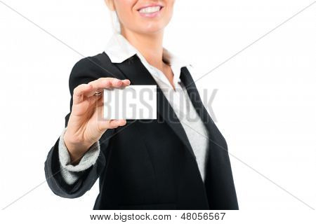 Young woman in front of white background, she introduces themselves with a businesscard, maybe she is a businesswoman or laywer
