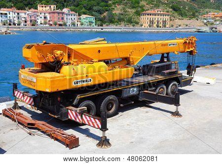 RIO MARINA, ITALY - JUNE 28: Big mobile crane Gottwald Tmk with load capacity 65000 kg. Vehicle for ship loading. June 28, 2013 in harbor of Rio Marina, Island of Elba, Italy.