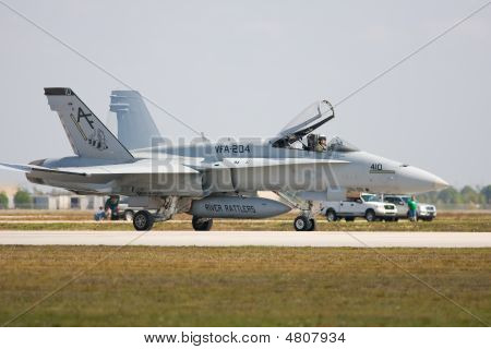 An F/a-18 Fighter Jet Taxis Past The Crowd For Take Off