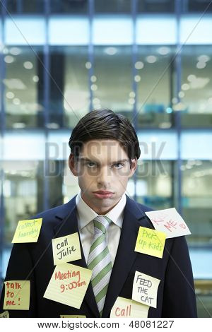 Portrait of a young businessman covered with post It notes