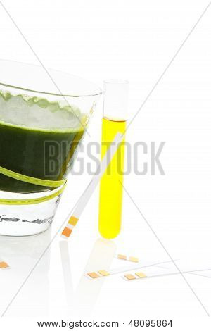 PH test strips litmus paper and urine in test tube glass with green juice isolated on white background. Minimal medical health care background. poster