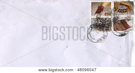 SOUTH AFRICA - CIRCA 2010: A stamp printed in South Africa shows image of the Whisk and Neckpiece and Tobacco bag and Apron, circa 2010.