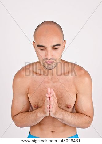 Man with hands closed, praying. Man doing yoga. poster