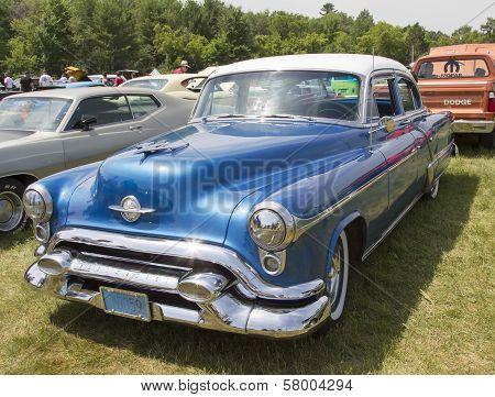 Blue Oldsmobile Ninety Eight