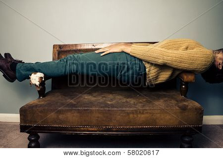 Young Man In Plank Position On Old Sofa