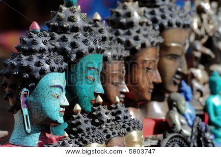 Hindu idol faces at Patan Durbar Square in Kathmandu, Nepal poster