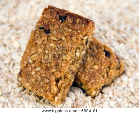 Two Flapjacks Stacked On An Oat Background