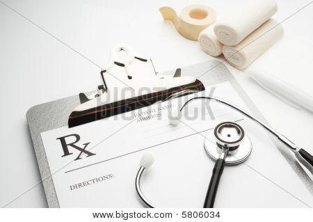 Rx Prescription On Clipboard With Stethoscope