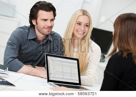 Broker Or Adviser With A Young Couple