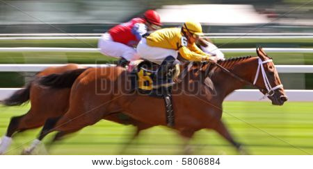 Slow shutter speed rendering of two racing jockeys and thoroughbreds poster