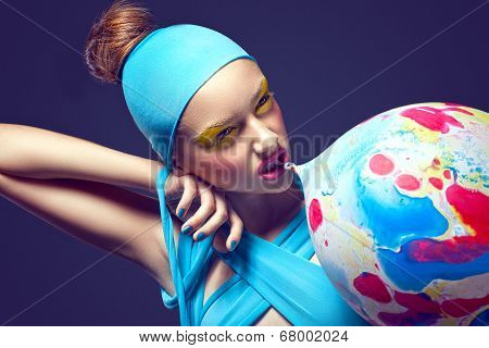 Grotesque. Eccentric Woman With Fancy Stagy Makeup And Air Balloon