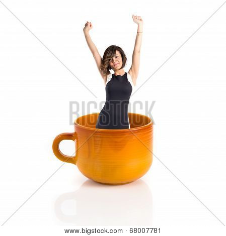 Woman inside ceramic cup over white backgrpund poster
