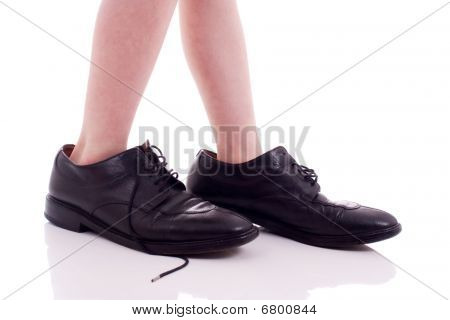 Child Wearing Adult Shoes