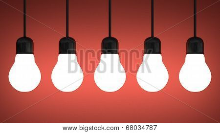 Hanging Glowing Tungsten Light Bulbs On Red