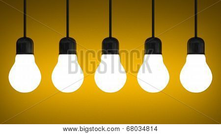 Hanging Glowing Tungsten Light Bulbs On Yellow