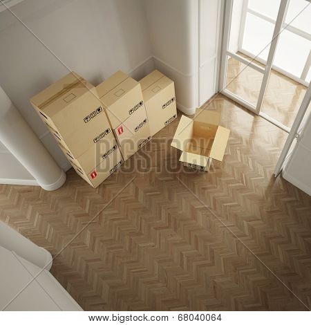 Many moving boxes from above in empty white room