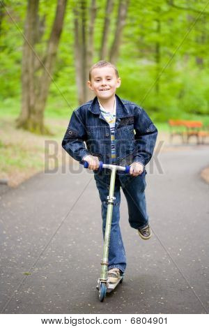 Cute Kid On Scooter