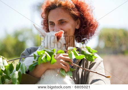 Woman And Cute Baby Goat