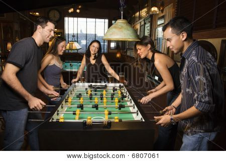 Group Of People Playing Foosball
