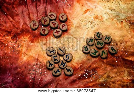 Set Of Runes Divided Into Aetts On Mottled Colorful Fabric