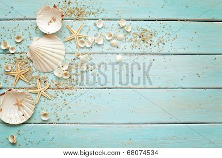 seashells frame on wooden background. nautical border