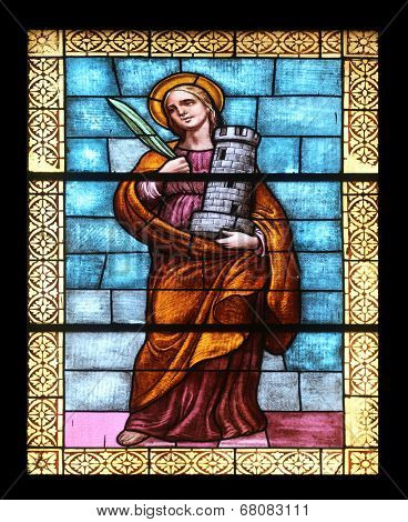 PORT AZZURRO, ELBA, ITALY - MAY 03: Saint Barbara, stained glass in the church of St. James the Greater. The church is located inside the fort of the same name in Porto Azzurro, Italy on May 4, 2014