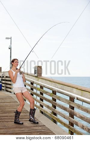 Woman catching a fish