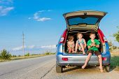 three happy kids in car, family trip, summer vacation travel poster