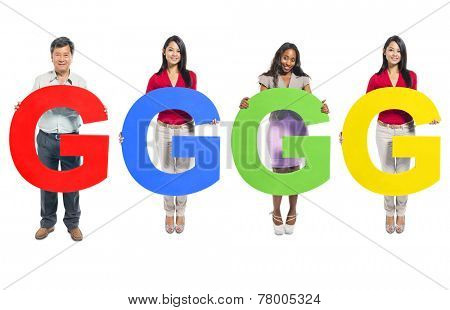Multi-ethnic group of people holding letter