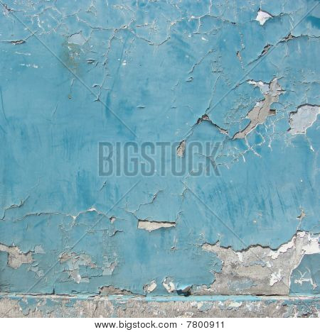 worn gray blue painted wall with paint chip crack and blathering