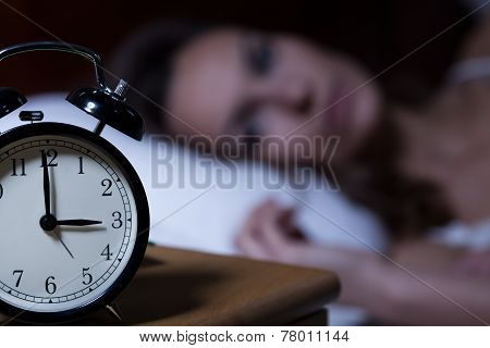 Alarm Clock On Night Table